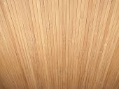 Background Made Of Vertical Dispersing Bamboo Laths.