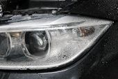 Macro View Of Headlight Detail Of Modern Automobile With Auto Projector Lens. Front View Of Vehicle  poster