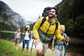 Group Of Young Friends Hiking In Countryside. Multiracial Happy People Travelling In Nature poster