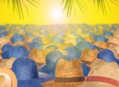 The Tops Of Straw Hats To Protect From The Scorching Rays Of The Sun On A Yellow Background. The Con poster