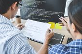 Two Professional Programmers Cooperating At Developing Programming And Website Working In A Software poster