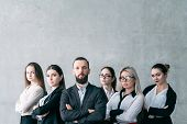 Confident Business Coach. Corporate Coaching. Team Of Company Professionals Posing With Arms Crossed poster