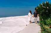 Man And Woman Traveling. Couple In Love Walking. Couple In Pamukkale. Travelling To Turkey. Lover. H poster
