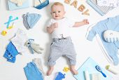 Cute Little Baby With Clothing And Accessories On White Background, Top View poster