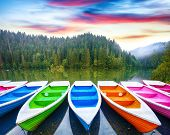 Boats On Majestic Mountain Lake Lacul Rosu Or Red Lake Or Killer Lake. Splendid Foggy Summer Scene O poster