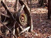 stock photo of wagon wheel  - an old wagon wheel found in the woods of sandston - JPG