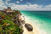 Idyllic beach of Tulum with people enjoying lagoon water - Mexico