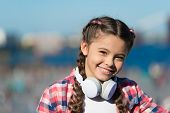 For Enjoying Sound Of Music. Adorable Music Fan With Wireless Headset On Neck. Little Child Using Te poster