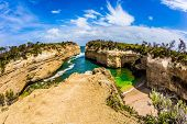 Small picturesque bay with green ocean water. The Great Ocean Road of Australia. The Pacific ocean.  poster
