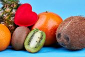 Whole Exotic Fruits And Half Of Kiwi Fruit. Composition From Ripe Exotic Fruits On Blue Background.  poster