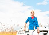 Tourist Woman In Front Of Car In Summer Field.