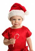 Cute Young Female Child With A Holiday Candy Cane