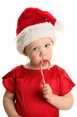Baby Sucking On A Christmas Candy Cane