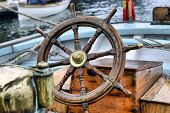 stock photo of ship steering wheel  - steering wheel on an old sailing ship - JPG