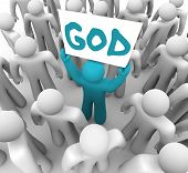 A blue person stands out in a crowd holding a sign with the word God on it, spreading the holy teach