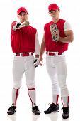 Two baseball teammates. Studio shot over white.