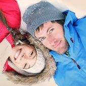 Winter couple happy. Overhead view of the heads of happy attractive interracial Asian / Caucasian co