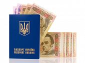 foto of passport cover  - International Ukrainian passport with Hryvna banknotes isolated on background - JPG