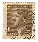 GERMANY - CIRCA 1937: A stamp printed in Germany shows image of Adolf Hitler was an Austrian-born German politician and the leader of the Nazi Party, in brown, circa 1937.
