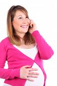Happy pregnant woman talks at cell phone isolated on white background.
