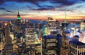 stock photo of skyscrapers  - New York City skyline with urban skyscrapers at sunset - JPG