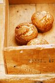 stock photo of bakeshop  - three poppy seeds and lemon muffins in wooden box - JPG