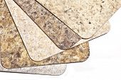 Samples of modern laminate flooring in earth tone shades.
