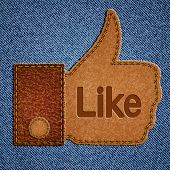 Like sign. Leather Thumbs up symbol on blue jeans background. Vector eps10 illustration