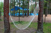The image of a hammock in a tourist camp