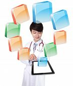 Doctor Using Tablet Pc With Colorful Icon
