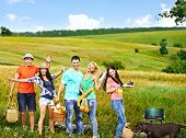 Group people with dog on picnic. Outdoor.