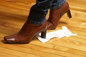 image of embarrassing  - A woman unknowingly tracks a piece of toilet paper on the bottom of her boot which makes for an embarrassing time - JPG