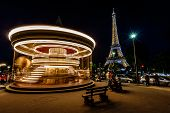 Moving Illuminated Vintage Carousel And Eiffel Tower, Paris, France