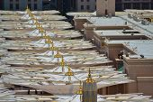Umbrellas in Nabawi Mosque at noon close up