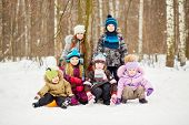 Group portrait of six children in winter park