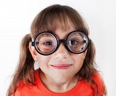 Funny Little Girl In Round Glasses