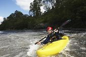pic of canoe boat man  - View of a young man kayaking in river - JPG