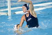 Jul 29 2009; Rome Italy; Greece team player Alexandre Asimaki holds on to USA team player Lauren Wenger while competing in the waterpolo semi final match between USA and Greece, USA won the match 8-7