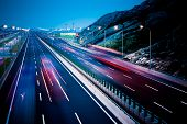 image of speeding car  - motion trucks on the freeway - JPG