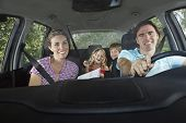 foto of seatbelt  - Portrait of smiling couple with two cheerful children in car - JPG