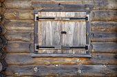 Secured Log House Window.