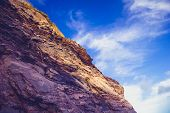 Rocky Cliffside Against Blue Sky