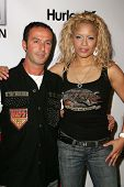 HOLLYWOOD - AUGUST 02: Jules Naouri with Blu Cantrell wearing Clothing by Antik Denim at Saturn's X-