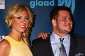 Chaz Bono and guest at the 24th Annual GLAAD Media Awards, JW Marriott, Los Angeles, CA 04-20-13