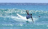 Acrobatic Surfer