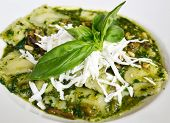 image of pesto sauce  - ravioli with pesto sauce cheese and basil leafs on white background - JPG