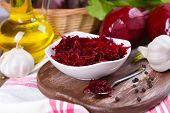 Grated beetroots in bowl on table close-up