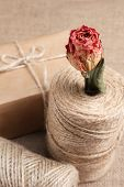 Natural style handcrafted gift box on sackcloth background. Concept of natural style design