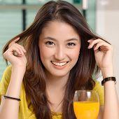 Cute Woman Drinking Orange Juice
