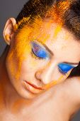fashion makeup with colored sand shadows, close up studio shot